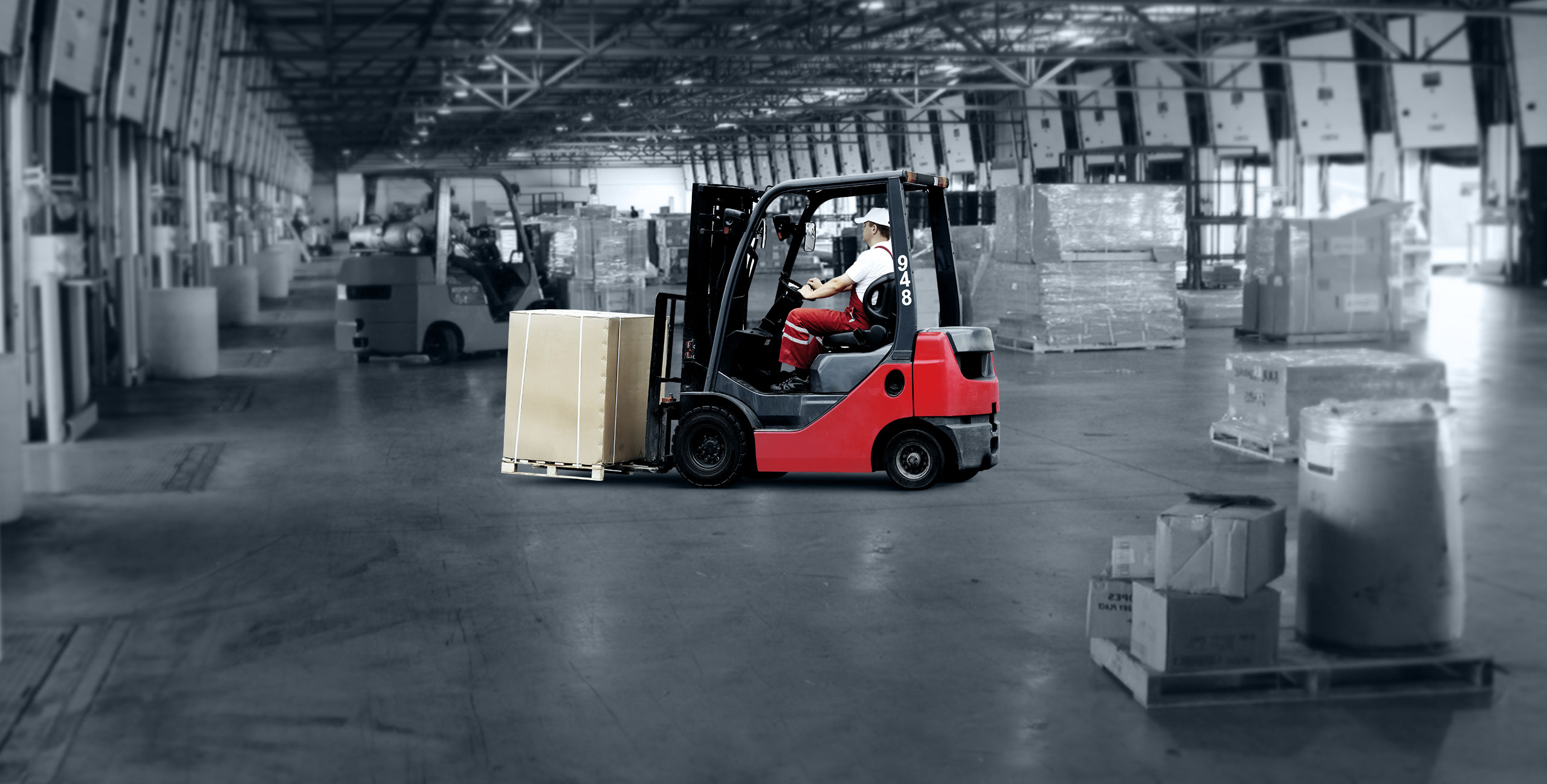 Forklift moving freight in cross dock facility